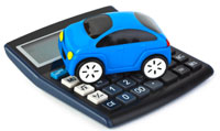Blue toy car on top of a black calculator