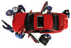 Overhead view of repair team diagnosing and repairing a red sports car