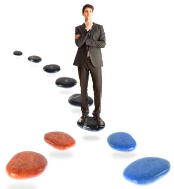 Man standing on a stone trying to decide which path to take
