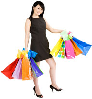 Young woman with hands full of shopping bags